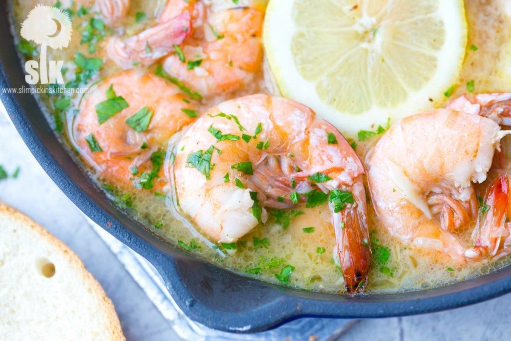 Lemon Shandy Peel and Eat Shrimp Recipe: A quick and easy peel and eat shrimp recipe that's made with lemon shandy beer, fresh garlic and herbs, butter and steamed shrimp!