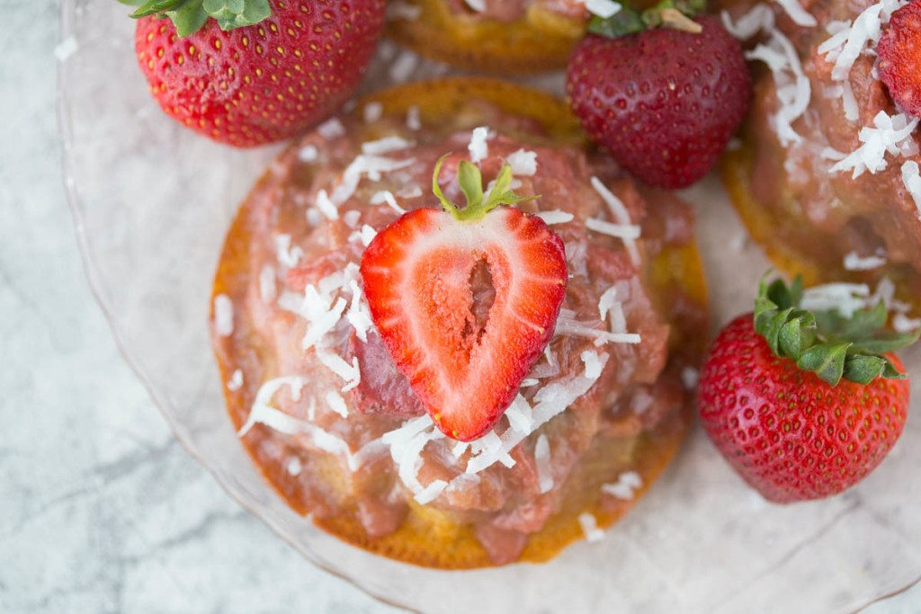 Mini Gluten Free Strawberry Rhubarb Upside Down Cake Recipe: Bursting with sweet strawberries, sour rhubarb, and a spritz of summery lemon, these gluten-free & refined sugar-free w/ vegan option Strawberry Rhubarb Upside Down Cakes taste like a breezy summer day in the Southern sun!